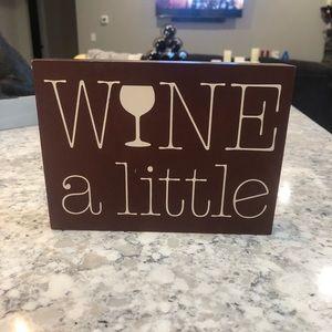 """Wine a little"" decorative sign"